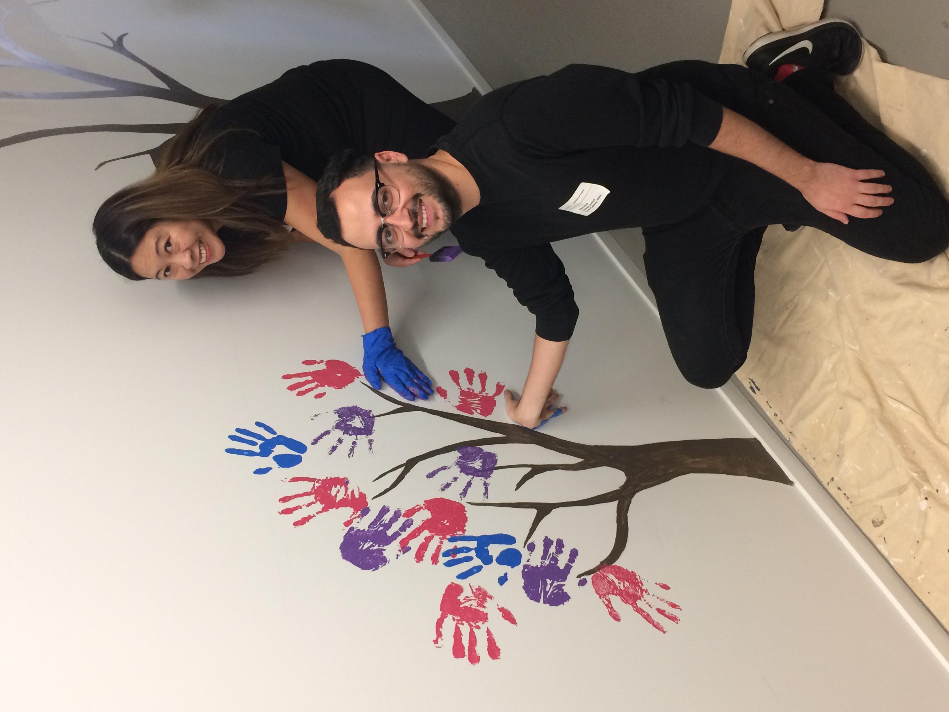 Volunteers paint murals