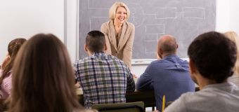 female teacher speaking to class